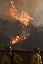 Cal Fire firefighters defend structures near Casitas Pass.