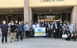 UCSB workers protested at Cheadle Hall on Wednesday, demanding that Chancellor Henry Yang send workers home with paid leave due to Thomas Fire issues.