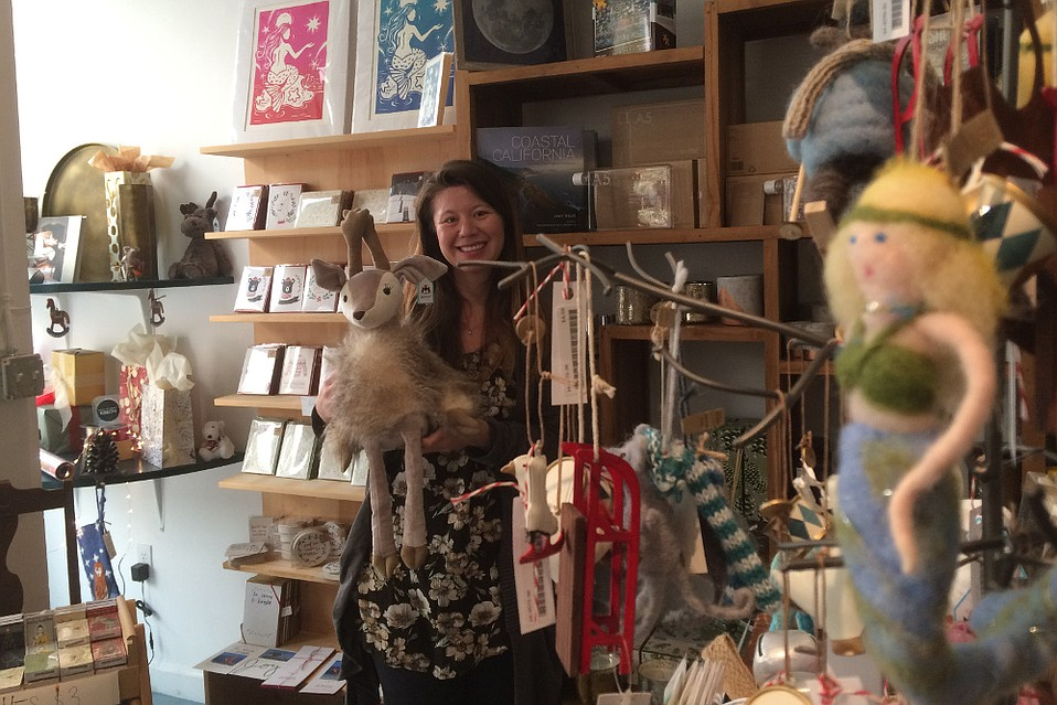 Folio Paper & Press is among the small businesses in Santa Barbara suffering an economic armageddon from the Thomas Fire, despite its incredible collection of children's toys — employee Christa Clark Jones holds a furry reindeer — letterpress cards, housewares, and more.