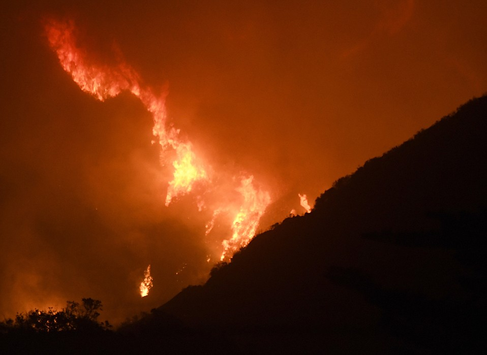The Thomas Fire burns in the foothills of Montecito pre-dawn Saturday. (Dec. 16, 2017)