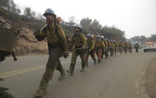 Firefighters work the Thomas Fire Saturday. (Dec. 16, 2017)