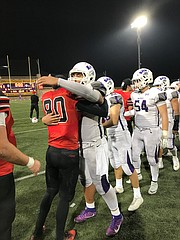 Bishop Diego defender Will Goodwin (80) and Detrius Kelsall, a powerhouse player for Shasta, show mutual respect after their battle for the California crown.
