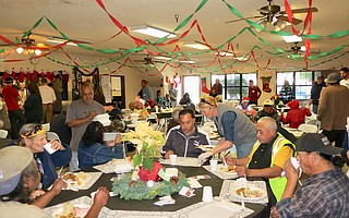 Guests enjoy the Christmas meal.