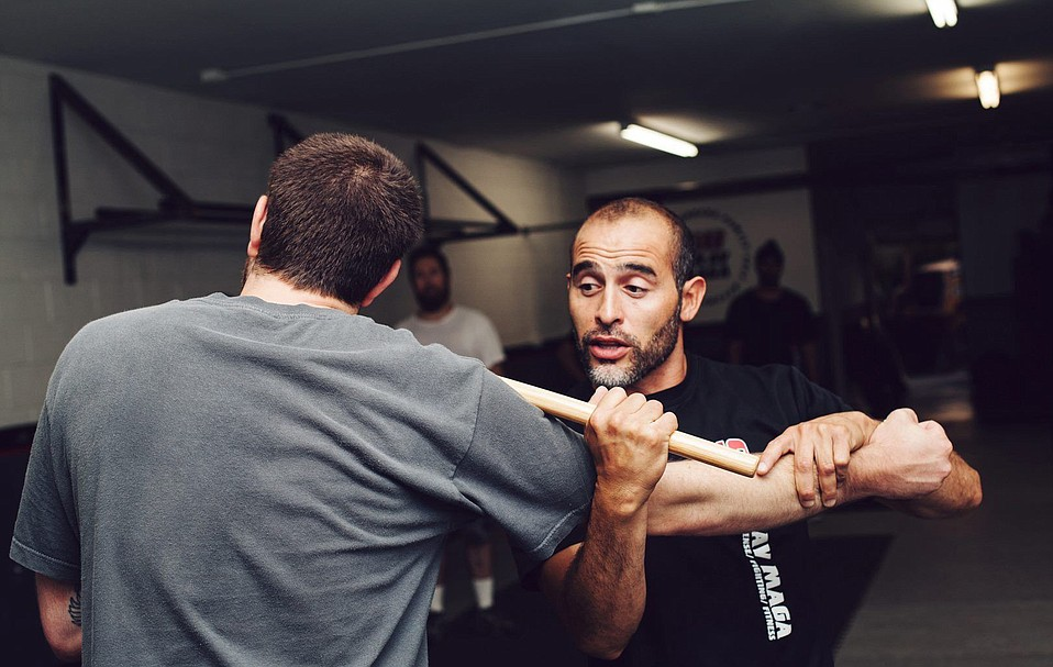 Krav Maga Family Self Defense Center lead instructor Pedro Sanchez (right)