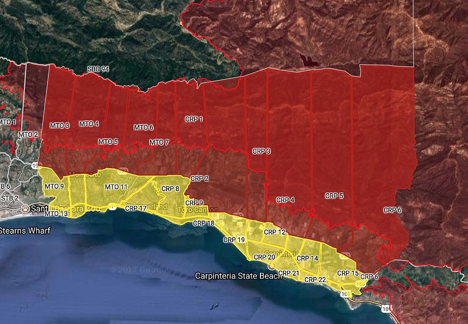 Post-Thomas Fire flooding concerns prompt a mandatory evacuation order in areas marked in dark red (best seen at countyofsb.org). Yellow marks voluntary evac zone. Canyons below Whittier Fire burn scar also in mandatory order.