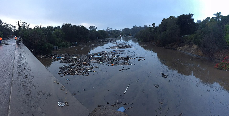 A view of Highway 101 from the Olive Mill Road overpass. The 101 is under unknown amounts of mud and debris after an early morning mudslide engulfed parts of Montecito.