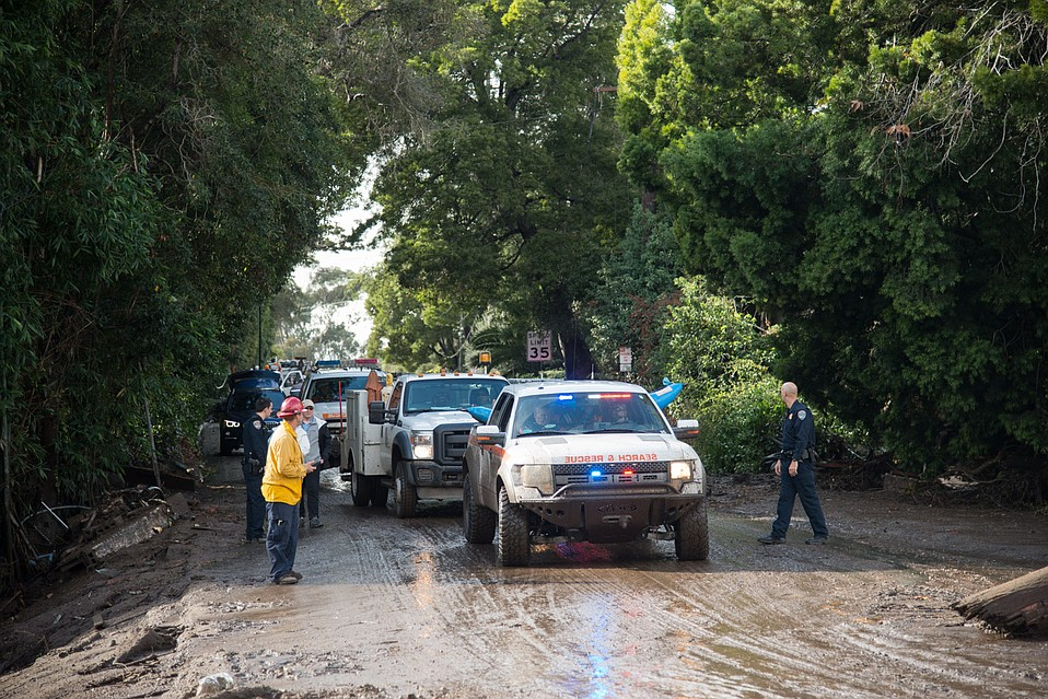 Search & Rescue personnel make their way up and down Hot Springs Road, conducting vehicle and watercraft rescues.