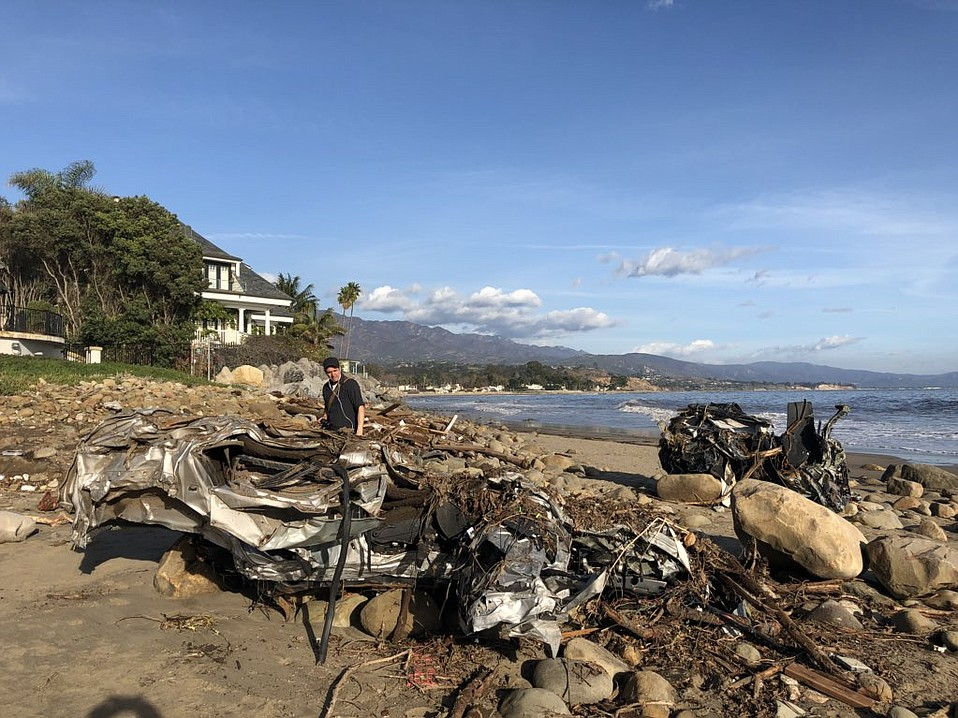 The force of the flash flooding Tuesday morning left a crumpled Hummer H3 and a Honda at the mouth of Montecito Creek.
