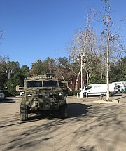 A Cal Guard vehicle parked in the Vons parking lot.