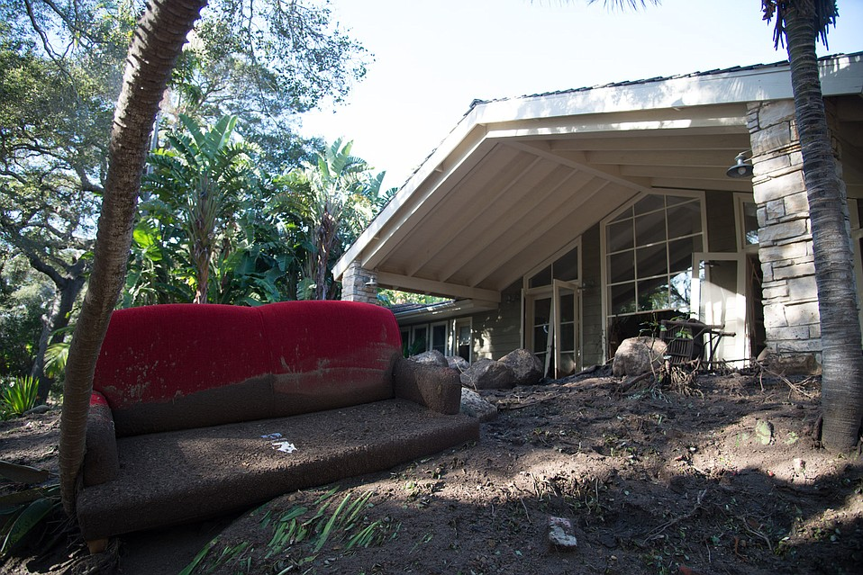 A home in the Riven Rock enclave adjacent to Hot Springs Creek suffered substantial damage when the bridge at East Mountain Drive diverted water into neighborhoods.