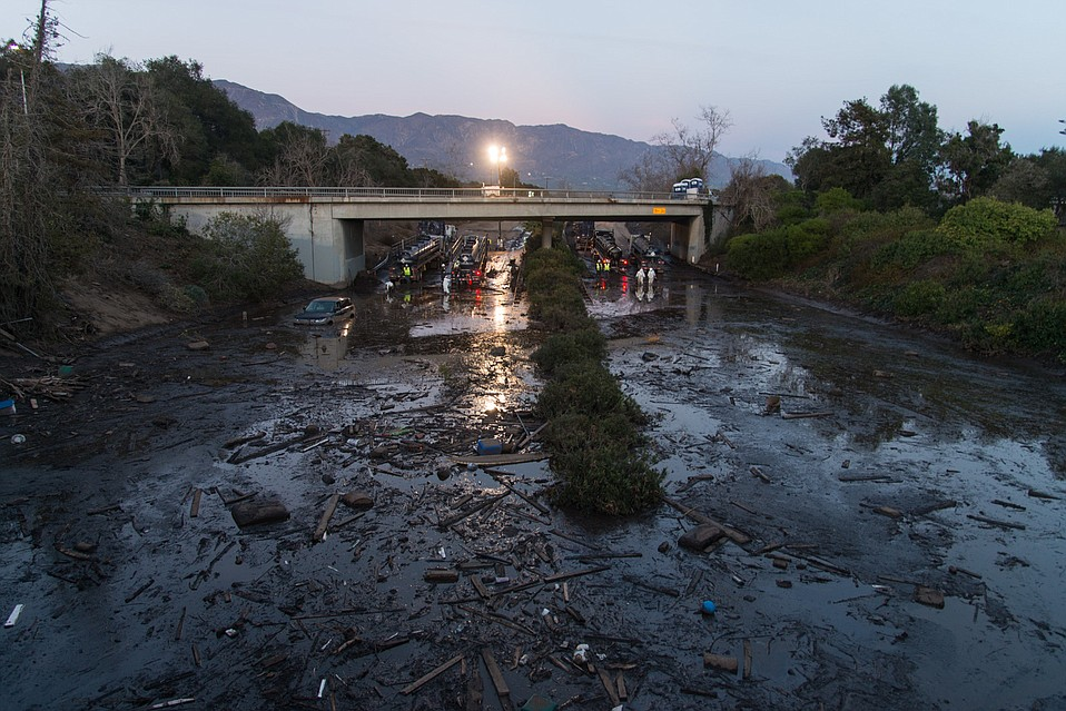 "Highway 101 near Coast Village Road remains inundated with at least 10 feet of mud and debris. Caltrans has been vacuuming the sludge into specialized tankers, eight of them working at a time. California Highway Patrol Captain Cindy Pontes said on Friday that the 101 would remain closed ""indefinitely."""