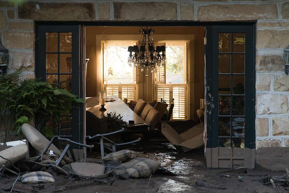 The living room of a home in disarray on Olive Mill Road