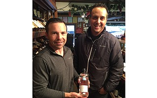 Owners Jason Herrick and Brian Brunello with a bottle of Casa Dragones tequila