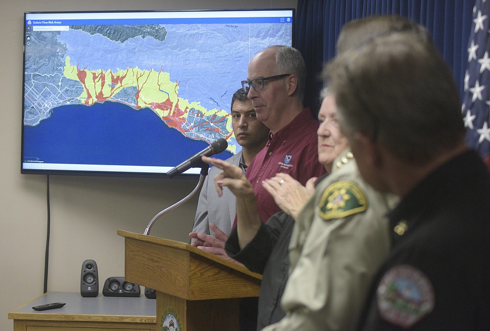Meteorologist Eric Boldt gives a weather update on Wednesday afternoon, with the debris flow risk areas map, available at readysbc.org, in the background.