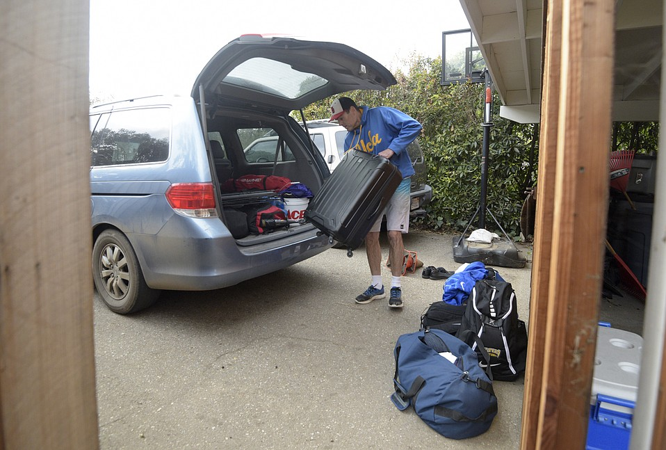 """Montecito resident Mike Denver loads up the car ahead of the pending storm to get the family to a hotel for the night. """"I'm not anticipating any real problems but just trying to be safe""""."""