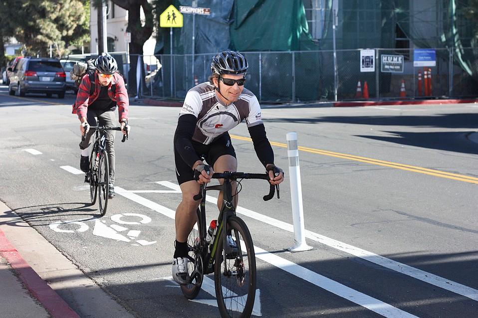 Riders cruise along the new Cota Street bike path