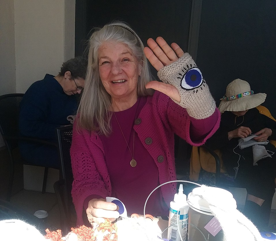 Join Charlotte Gould and the 'evil eye' knitters and sewers at Peet's Coffee March 12 and 19 to create fingerless gloves for the March for Our Lives on March 24.
