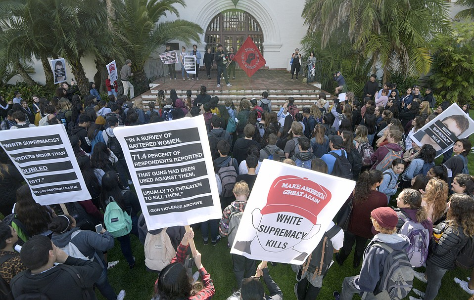Santa Barbara High School students take part in a nation-wide protest against gun violence following the massacre at Marjory Stoneman Douglas High School by walking out of class and marching to a rally at the courthouse sunken gardens.