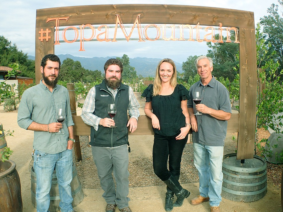 The Topa Mountain team—from left, cellar master Alex Tombelli, winemaker Dominic O'Reilly, tasting room manager Jackie Franklin, and owner Larry Guerra—stands at the best place to spot Ojai's sunset shade of pink.