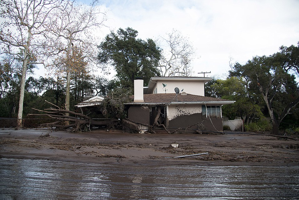 Owners of damaged homes may have to wait for new flood maps before being allowed to rebuild.