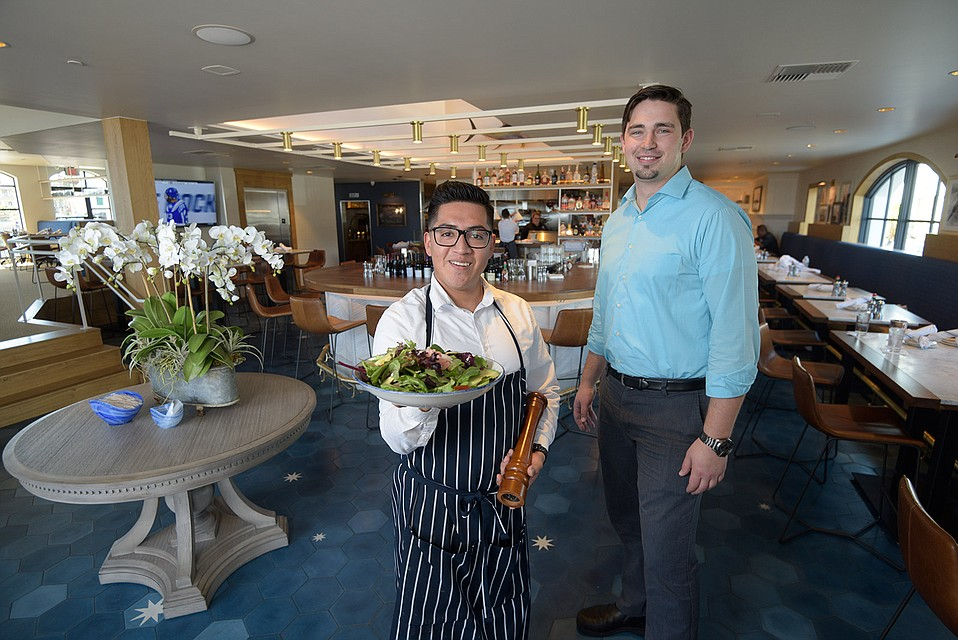 Server Daniel Cruz (left) with General Manager Colin Lohenry