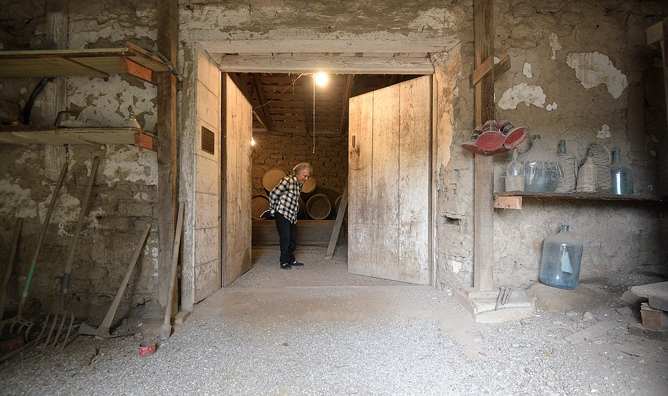 Now 80 years old, Catherine Cavaletto is the caretaker of San Jose Winery, located in the hills above Goleta. Though weathered by nearly 200 years of time, its thick adobe walls still house old barrels, vats, presses, and bottles such as the wicker-wrapped demijohns below.
