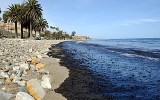 Spilled oil laps onto Refugio Beach.