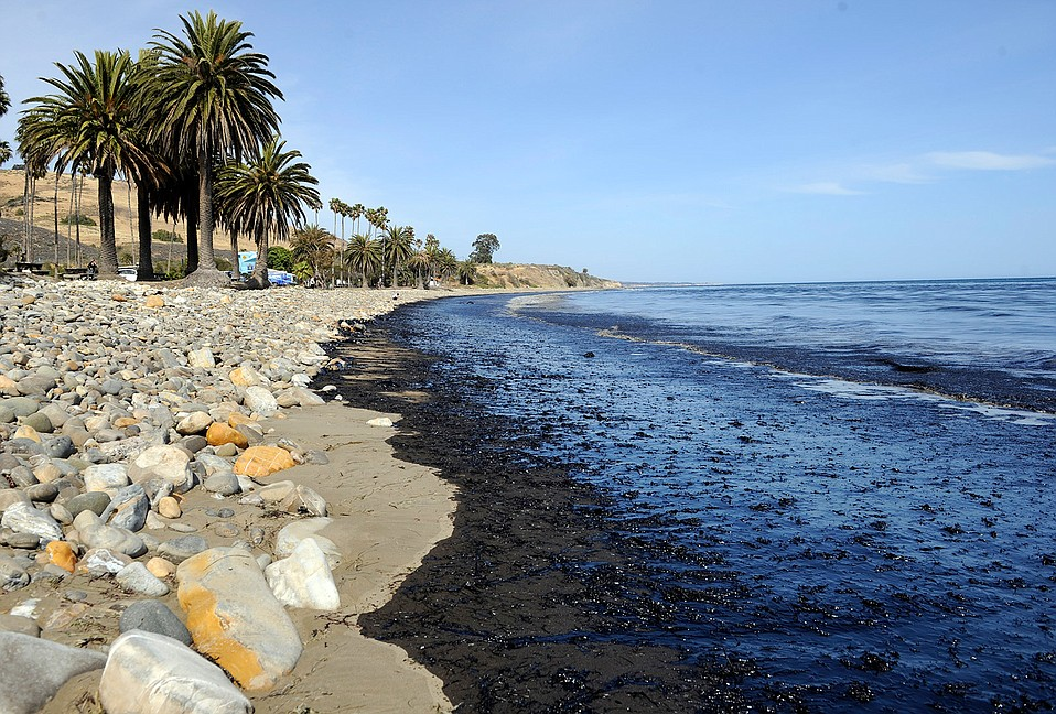 Spilled oil laps onto Refugio Beach.