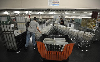 Mail is sorted at a Goleta postal processing facility.