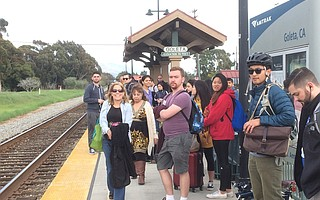 Goleta workers and UCSB students get ready to board the new commuter train.