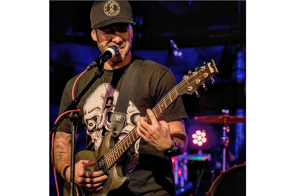 Kyle Smith, who melds rock and reggae into his acoustic ballads, is just one of the musicians slated to play at The Happy Concert.
