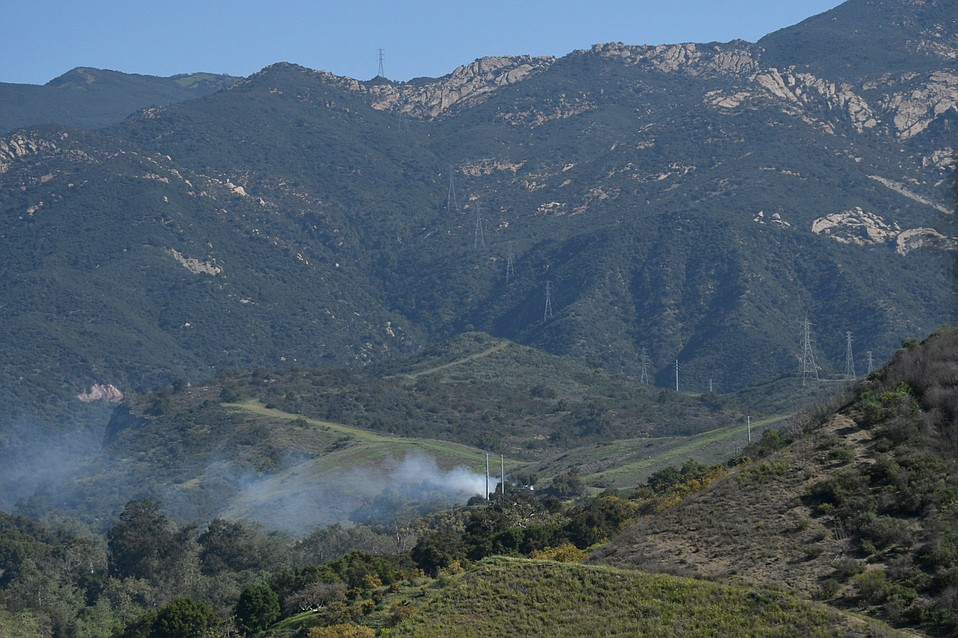 A power line that was downed in the collision started a quarter-acre fire in Ellwood Canyon this morning.