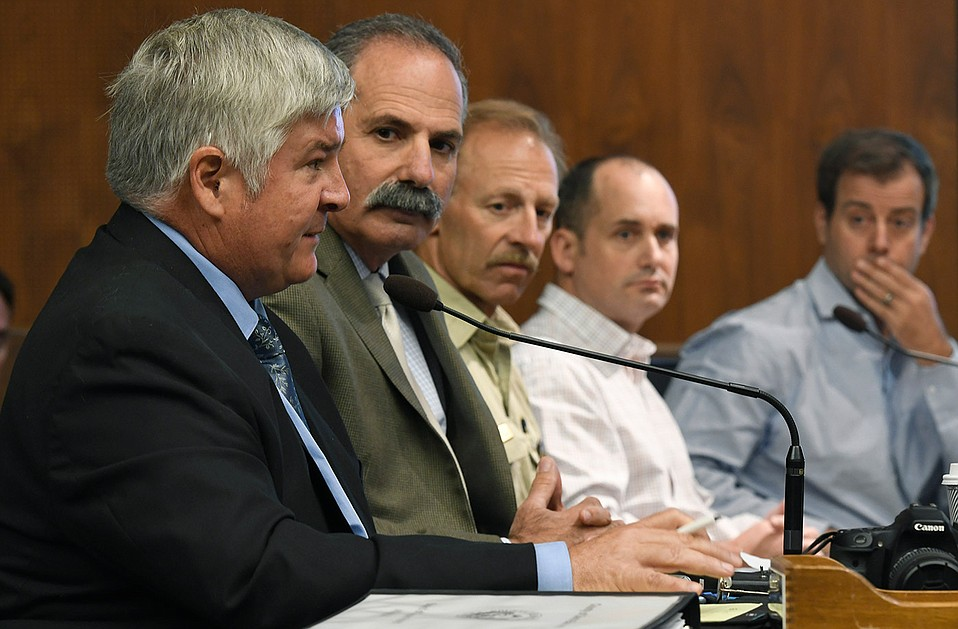 County Public Works Director Tom Fayram (left) addresses county supervisors with (from left) Office of Emergency Management Director Rob Lewin and the U.S. Forest Service's Kevin Cooper, among others.