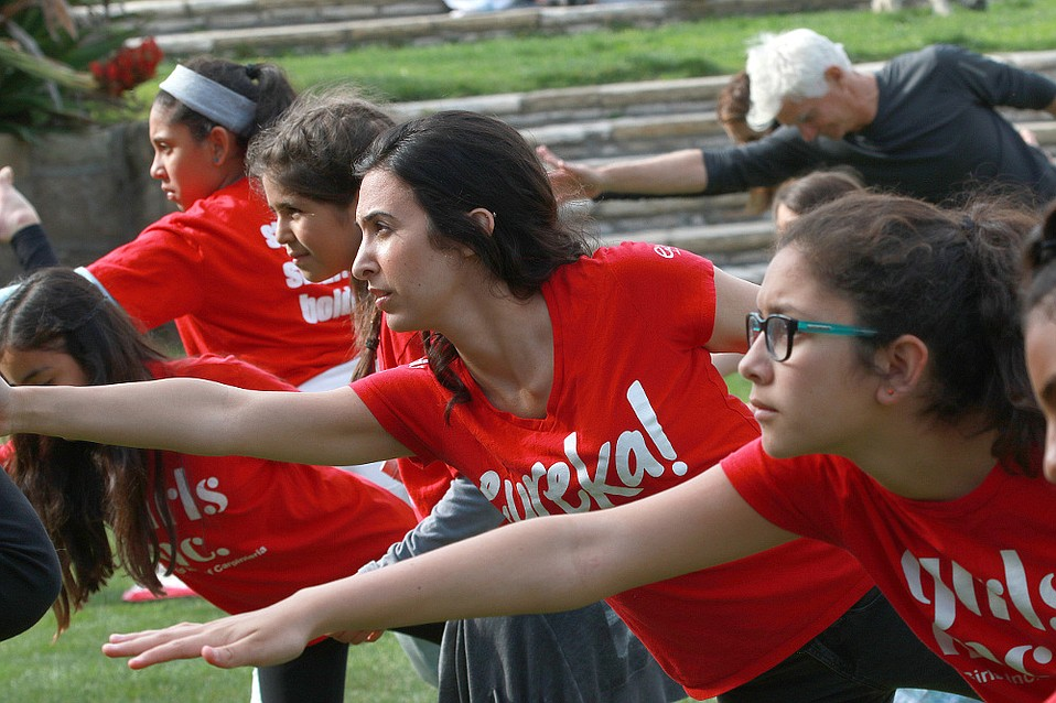"""HOLISTIC APPROACH:  Girls Inc. members participated in """"Yoga on the Lawn"""" last April to promote exercise for physical and mental wellness."""