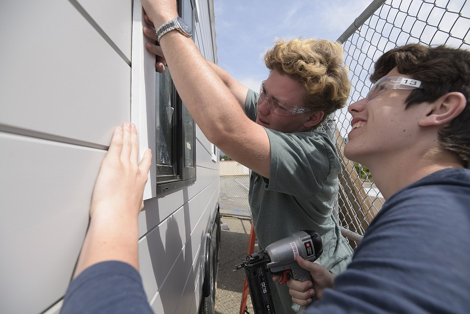 Students at San Marcos High School hard at work on their tiny home.