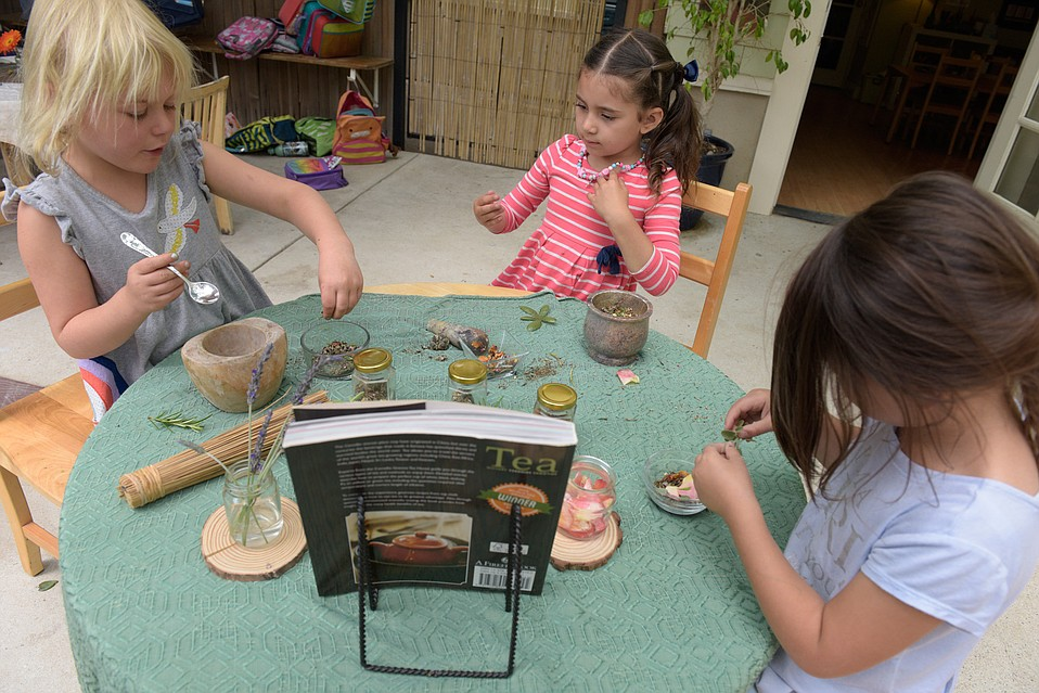 Izzie, Eloise, and Mia make some mindful tea at Bright Start Child Development Center.