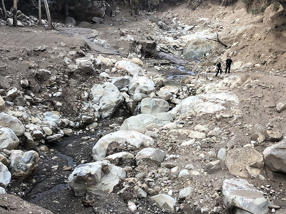 Preliminary data from Dunne's surveys suggests that the debris flow was more than 20 feet deep at the Cold Springs trailhead on East Mountain Drive. Photo by Mike Eliason, Santa Barbara County Fire Department.