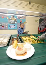 Kenya Alonzo getting breakfast at Harding School