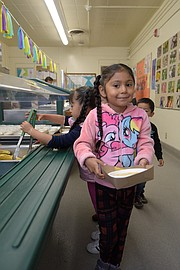Daniella Nava getting breakfast at Harding School