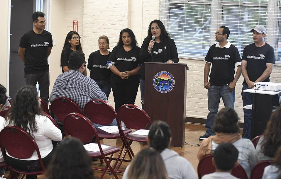 Parents of students describe personal experiences at a Future Leaders of America meeting at the Louise Lowry Davis Center