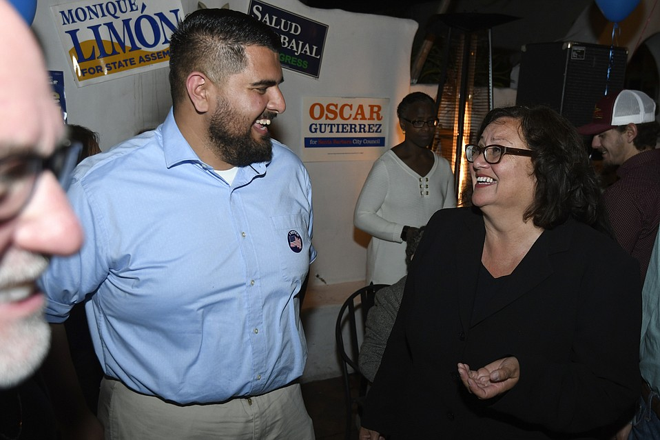 District Three City Council Candidate Oscar Gutierrez celebrities early, good news with Mayor Cathy Murillo on election night at Casa Blanca restaurant in Santa Barbara.