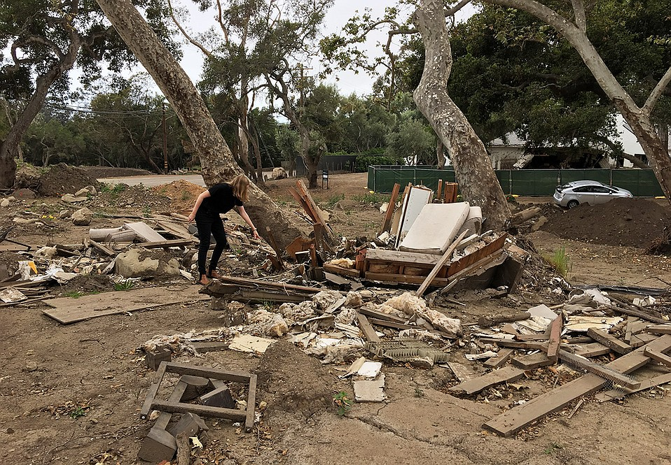 A pile of broken furniture and pieces of drywall is all that is left of the home that belonged to Brian and Karen MacDonald at 620 Randall Road. Some of the property owners on Randall are looking into the possibility of selling their land for a debris basin.