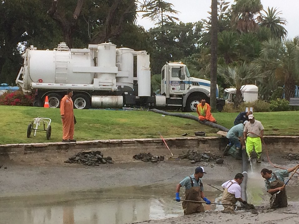City of Santa Barbara parks employees worked with a contractor crew initially to vacuum the muck from the pond at Alice Keck Park Memorial Gardens, which they found to be more than five feet deep in places.