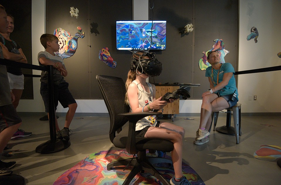 Branna Burke, visiting from Ventura, experiences Blortasia, a virtual-reality exhibit at the Wolf Museum of Exploration + Innovation (MOXI)