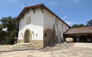 The main chapel at La Casa de Maria (pictured) took a direct hit during the 1/9 Debris Flow. A few feet of mud, boulders, and branches flooded inside.