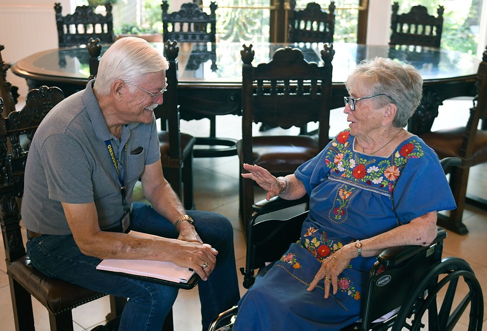FSA's Michael Leu, a former Apollo engineer and now a long-term-care ombudsman, meets with Mary Modjeski at Mission Terrace Convalescent Hospital, where she is recuperating from a fall