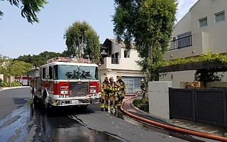 Multiple fire companies responded to a blaze in a closely clustered townhouse complex.
