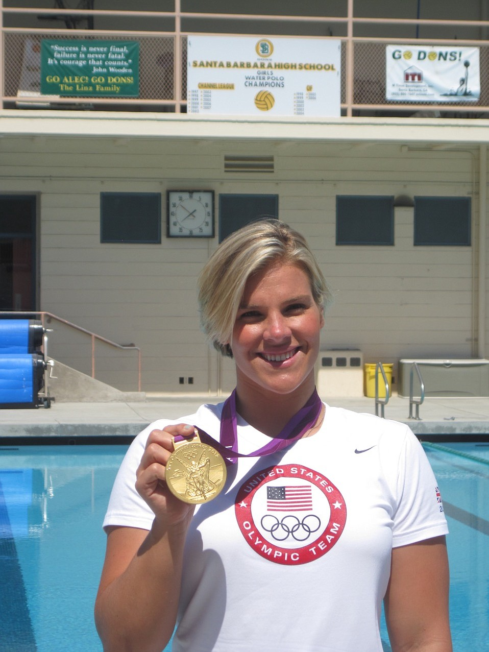 Kami Craig displays the gold medal she won with the U.S. water polo team at the 2012 Olympic Games in London.