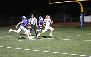 Santa Maria running back Samuel Herrera breaks free from the San Marcos defense for one of his three touchdowns.