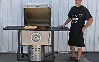 Peck Euwer shows off the Ferno Grill, that is designed and assembled in Goleta, with a uniquely adjustable propane flame height as opposed to raising or lowering the grill.